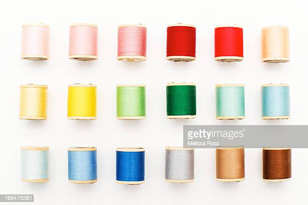 Colorful spools of thread on a white background