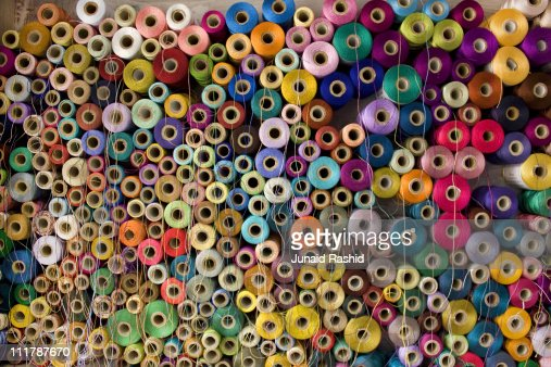 Colorful stack  of Pakistan's Cotton Thread Reels : Stock Photo