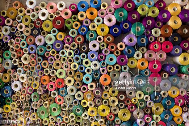 Colorful stack  of Pakistan's Cotton Thread Reels