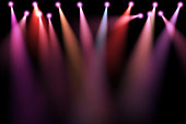 colorful stage lights, projectors in the dark, purple,red,blue soft light spotlight strike on black background