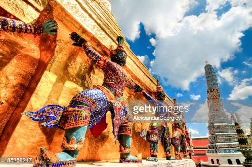 Colorful statues guarding temple at Wat Phra Kaew