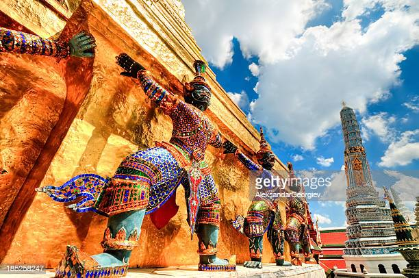 Colorful statues guarding temple at Wat Phra Kaew