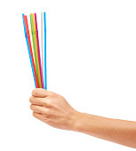 colorful straw in hand isolated on white background