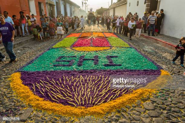 Colorful street carpet (alfombra) about to be trampled by Semana Santa religious procession