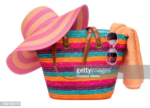 Colorful Striped Beach Bag With Straw Hat Towel And Sunglasses ...