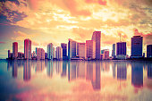 Beautiful colorful city of Miami Florida skyline and bay with dramatic clouds at sunset