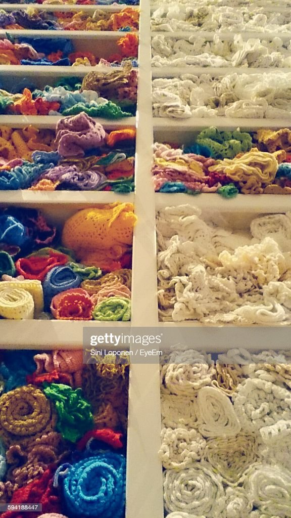 Colorful Tablecloths Arranged In Shelves At Store For Sale