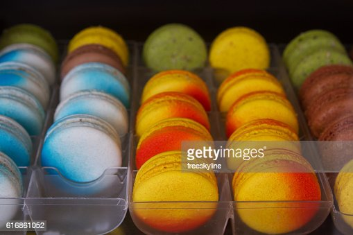 Colorful tasty macaroons in a row. Street food : Stock Photo