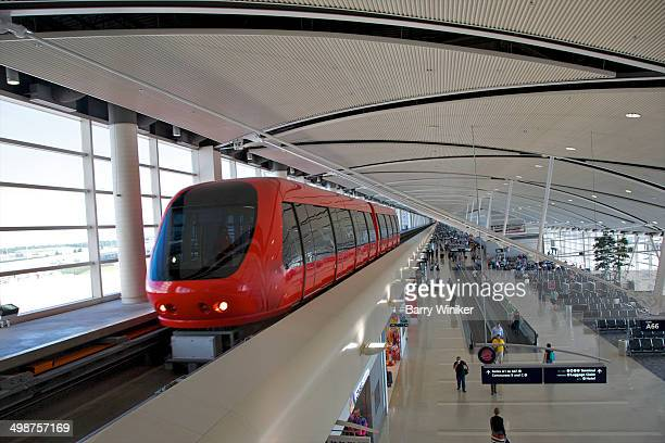 Colorful tram that travels above people in airport