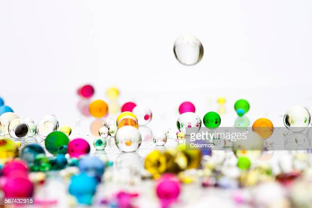 Colorful transparent beads on white background