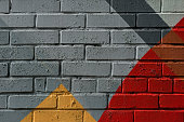Colorful very small fragment of street graffiti, brick wall. Abstract creative drawing fashion colors. For backgrounds and backdrops