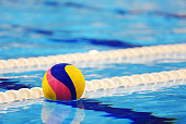 Colorful water ball in swimming-pool
