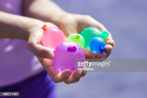 Colorful water balloons in hands