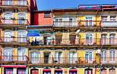 Colorful water front homes in Ribeira neighborhood of Porto, Portugal, overlooking Douro river.