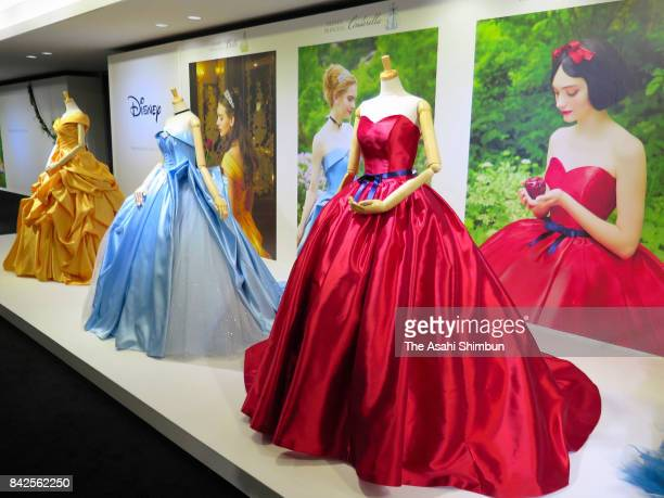 Colorful wedding dresses representing six popular Disney princesses are displayed on August 30 2017 in Tokyo Japan Fourteen designs featuring six...
