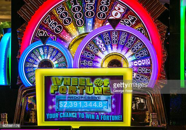 A colorful 'Wheel of Fortune' slot machine is viewed at the Wynn Hotel Casino on December 7 2015 in Las Vegas Nevada Tourism in America's 'Sin City'...