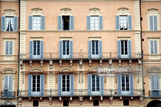 Colorful windows with shutters in Siena, Italy
