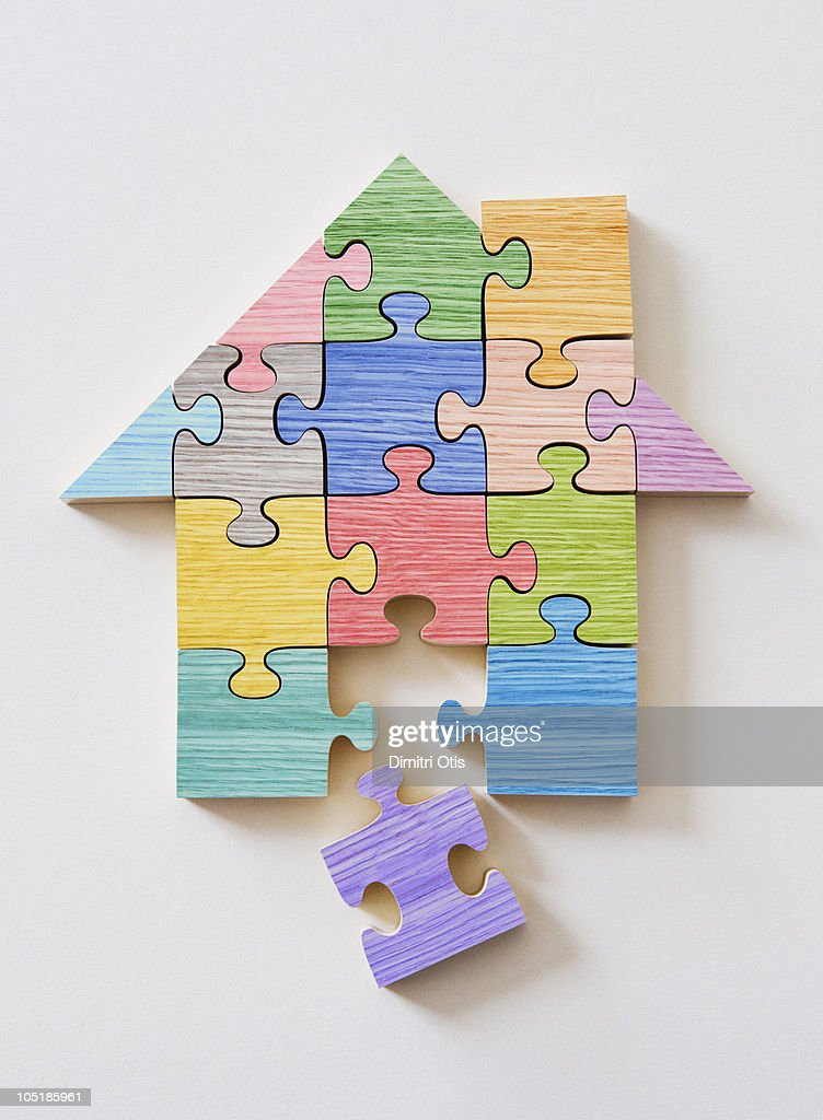 Colorful wooden house shaped puzzle pieces : Stock Photo