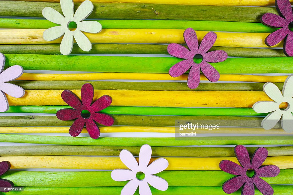 Colorful wooden sticks with flowers background : Stock-Foto