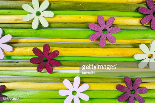 Colorful wooden sticks with flowers background : Stockfoto