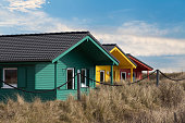 Helgoland city - colorful wooden tiny houses on the island Dune near island Helgoland against blue sky