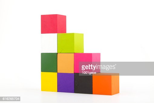 Colorful woods cube arrange in stairs shape isolated on white. : Stock Photo