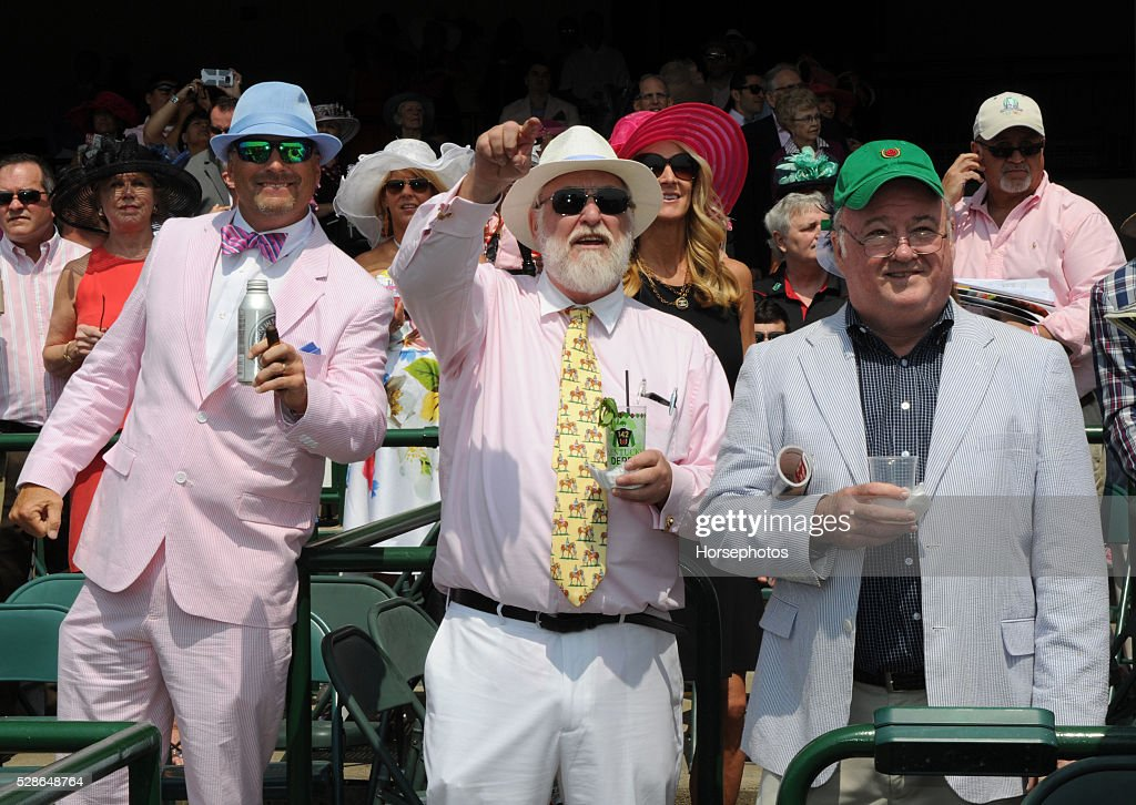 Colorfully dressed race fans during Kentucky Oaks Day at Churchill Downs on May 6, 2016 in Louisville, Kentucky.