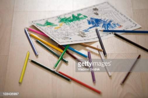A coloring book page and colored pencils, still life