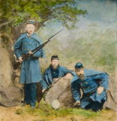 Colorized photograph showing three Union Army soldiers holding rifles with bayonet ca1865