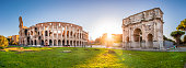 Panoramic view of Colosseum and Constantine Arch at dawn, Rome, Italy
