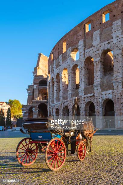 Colosseum (Colosseo) and horse cart. Rome, Italy.