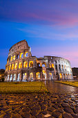Colosseum in Rome , Italy at twilight