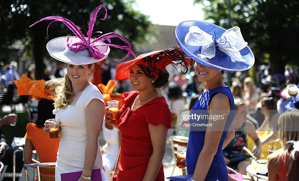 Colour and fashion at Newmarket racecourse on July 11, 2013 in Newmarket, England.