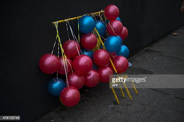 Colour balls for sell during the street carnival in Salvador northeastern Brazil on March 2 2014 AFP PHOTO/HIROSUKE KITAMURA