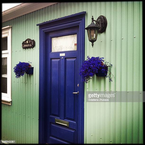 Colour detail blue doors on a typical Icelandic corrugated iron house in Reykjavik Iceland August 2014