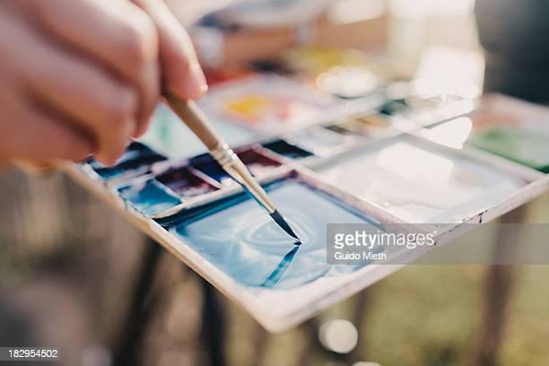 Colour mixing on a watercolour pallette