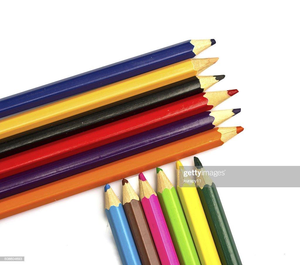 Lápices de colores sobre fondo blanco primer plano : Foto de stock