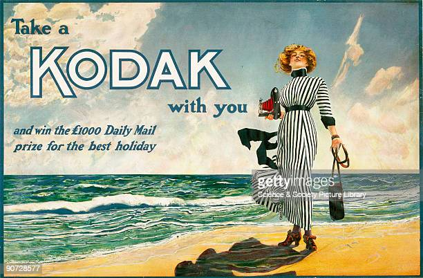 Colour poster produced for Kodak Ltd showing the 'Kodak Girl' standing on a beach holding a small camera and case promoting a Daily Mail holiday...