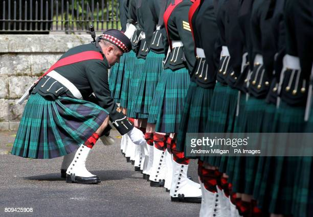 A Colour Sergeant inspects the uniform of a soldier in the Ballater Guard made up of soldiers from the Argyll and Sutherland Highlanders 5th...