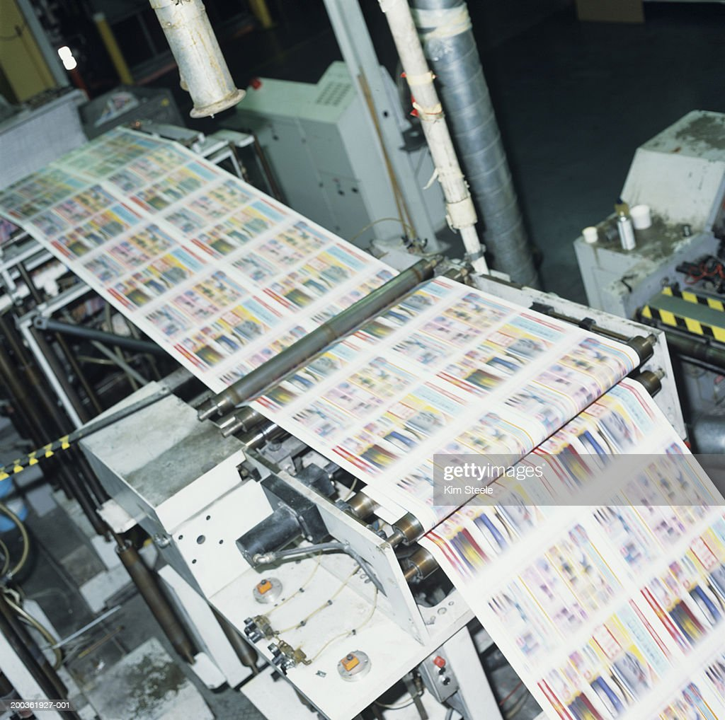 4 colour thermal ink web press in factory, elevated view : Stock Photo