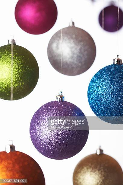 Coloured baubles hanging, close up