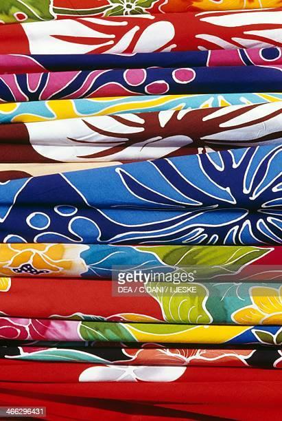Coloured fabrics at Papeete market Tahiti Society Islands French Polynesia