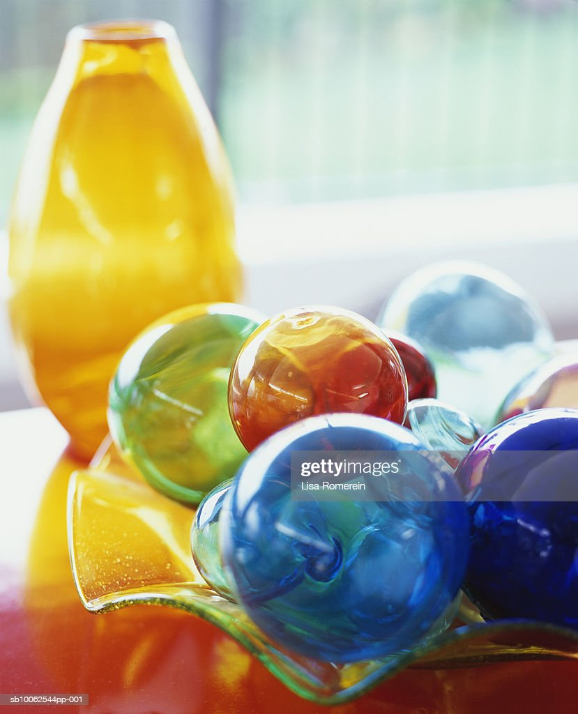 Coloured glass balls, dish and vase : Stock Photo