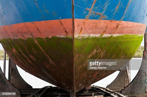 Coloured hull covered with algae in the dry dock, Hvide Sande, Jutland, Denmark, Europe