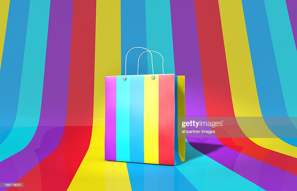 Coloured paper-bag on a multi-coloured background : Stock Photo