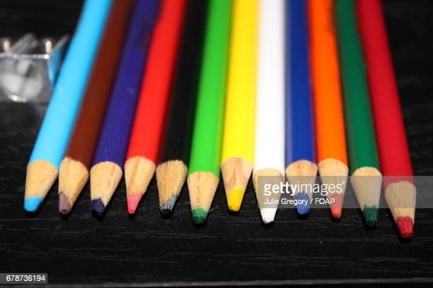 Coloured pencils against black background