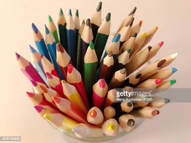 Coloured pencils in container