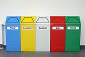 Coloured recycling bins marked with 'Paper Pastic Other Waste Glass and Metal' stand in a factory on January 4 2013 in Aurich Germany Germany has...