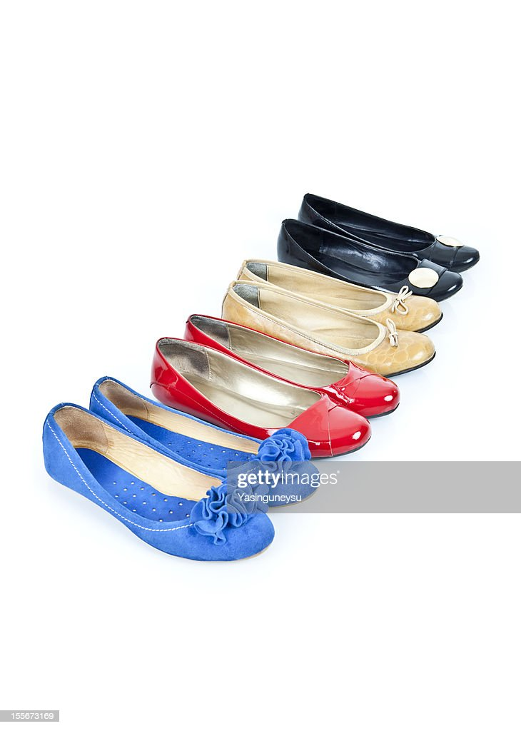 Coloured shoes on a white background : Stock Photo