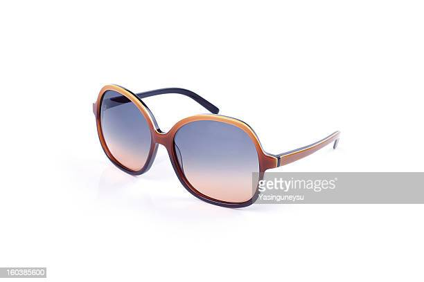 Coloured sunglasses on a white background
